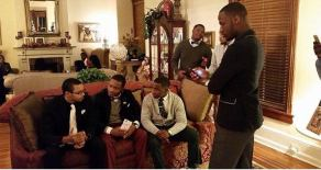 Photo from Christmas Leadership Social, SGA Officers alongside 100 Black Gentlemen.